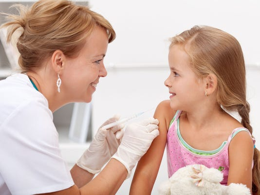 stock-photo-little-girl-getting-vaccinated-shot